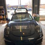 Porsche convertible in repair shop