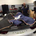 Porsche with Discount Auto Glass employee