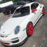 white car with red rims
